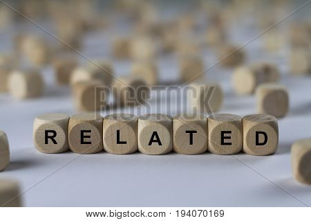 related - cube with letters sign with wooden cubes poster