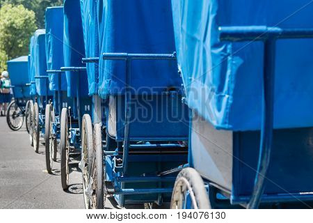 Alignment Of Blue Wheelchairs In Front Of The Swimming Pools In The Sanctuary In Lourdes