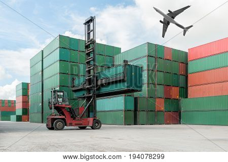 Forklift lifting container box loading to container depot use for cargo import export logistics background with cargo airplane flying above container depot near logistics port.
