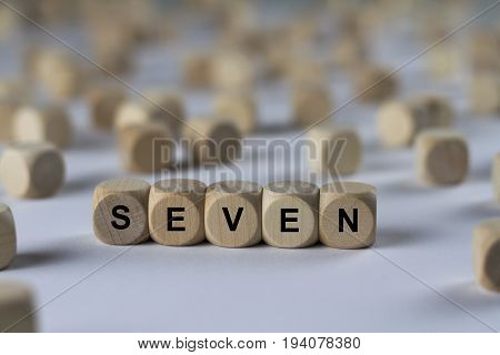 Seven - Cube With Letters, Sign With Wooden Cubes