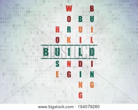 Building construction concept: Painted green word Build in solving Crossword Puzzle on Digital Data Paper background