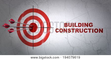 Success construction concept: arrows hitting the center of target, Red Building Construction on wall background, 3D rendering