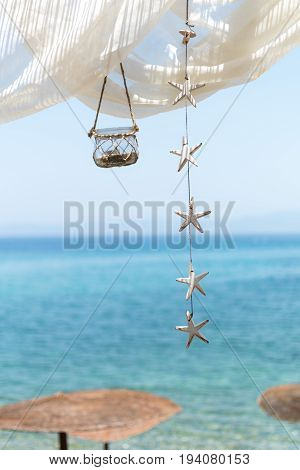 View To The Sea From A Beach Bar, With Canopy, Lantern And Stars Hanging From Above