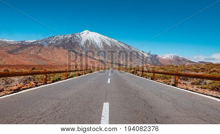 Road in volcanic desert Tenerife, Canary. Asphalt and white line on road