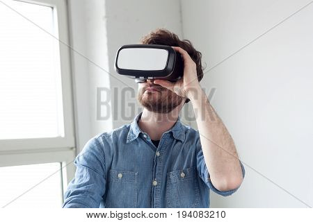 amazed young  man wearing virtual reality goggles