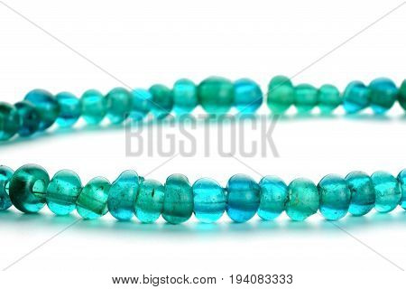 Ancient glass trade beads in necklace on white background