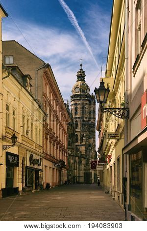 KOSICE, SLOVAKIA - APRIL 15, 2017: Street in the center with the Elisabeth cathedral. Kosice is the 2nd largest city in Slovakia with 555, 800 people living in metro area.