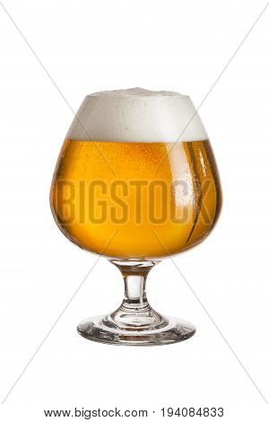 Glass of cold light beer isolated on white background