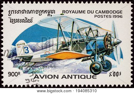 Moscow Russia - July 06 2017: A stamp printed in Cambodia shows American cargo aircraft Stearman C-3MB (1927) for the transport of mail series Biplanes