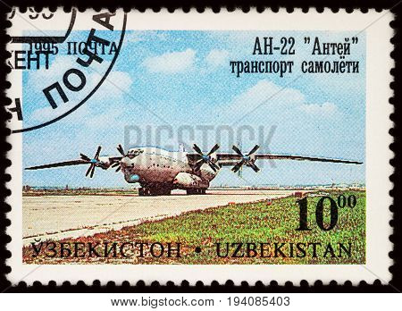 Moscow Russia - July 05 2017: A stamp printed in Uzbekistan shows transport plane Antonov AN-22 (Antaeus) series