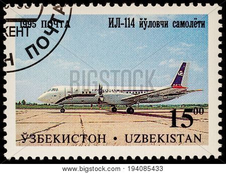 Moscow Russia - July 05 2017: A stamp printed in Uzbekistan shows airliner Ilyushin IL-114 series