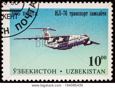 Moscow Russia - July 05 2017: A stamp printed in Uzbekistan shows heavy military transport aircraft Ilyushin IL-76 series