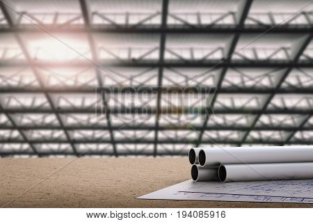 civil engineer concept with 3d rendering metal pipes and blueprint paper