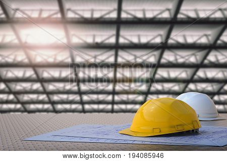 civil engineer concept with 3d rendering safety helmets and blueprint paper