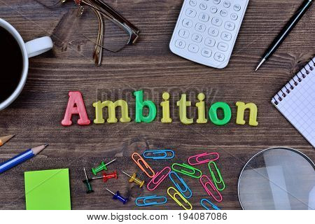 Ambition word on wooden table close up