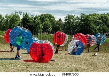 Children playing in Bubble Soccer Football outdoor