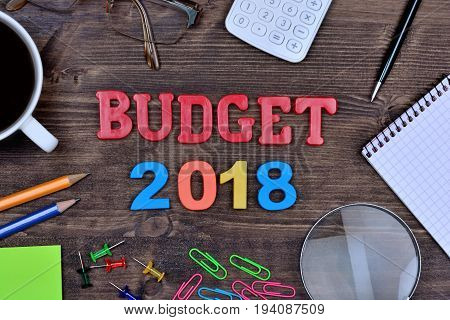 Budget 2018 on wooden table close up