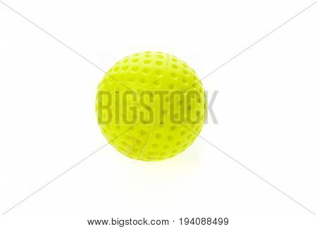 Fluorescent yellow old and dirty golf ball isolated on white. Colour olfing sports equipment and accessories isolated on white background.