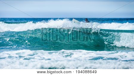 Background Picture Of Big Waves And A Surfer.