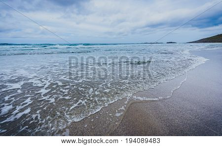 Small Ocean Sea Waves On Sandy Beach In Calm Weather.