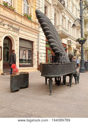 The pianist from Piotrkowska Street. Lodz, Poland - June 13, 2017 Monument of the pianist Arthur Rubinstein, Piotrkowska Street in Lodz.