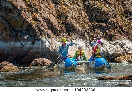 Village Myhiya Nikolaev region Ukraine - July 2 2017: Kids and rafting. A popular place for extreme family recreation and training of athletes in rafting and kayaking.