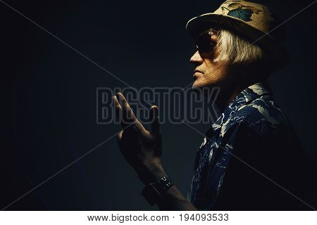 Man In Colorful Clothes With Hat