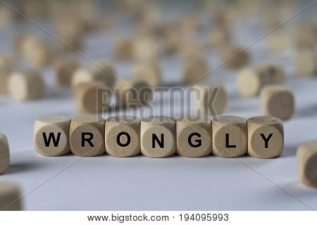 Wrongly - Cube With Letters, Sign With Wooden Cubes