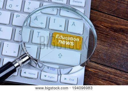 Education news on computer keyboard button closeup