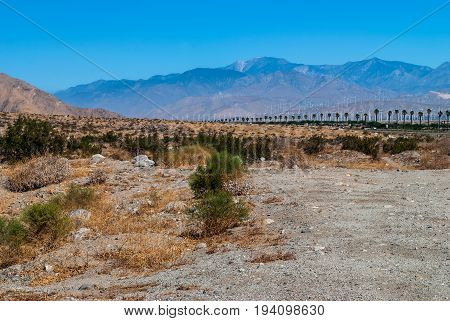 Windmills off in the distance along the San Jacinto Mountain range near Palm Springs California.