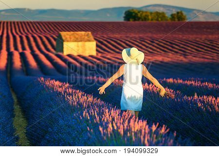 Wonderful free happy woman enjoying nature. Freedom concept with stunning lavender field.