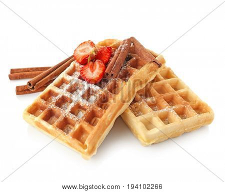 Delicious cinnamon waffles with strawberry isolated on white
