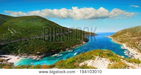 Panoramic view on amazing bay, boats and ships with swimming people in Ionian Sea blue water near to Blue Caves. Zakynthos island sightseeing point Greece, Porto Vromi. Panorama 180 degree