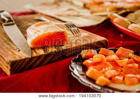 fresh salmon red fish on wooden board