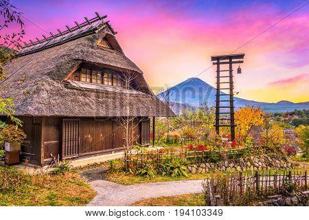 Mt. Fuji, Japan with historic village Iyashi no Sato during autumn