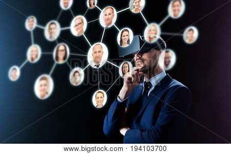 business, people, headhunting, augmented reality and modern technology concept - businessman in virtual headset looking at contacts network over black background