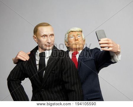 Caricatures of US President Donald Trump with Russian President Vladimir Putin taking a selfie - using toy action figures