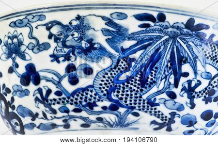 Closeup of antique 18th century Chinese porcelain four claw dragon.