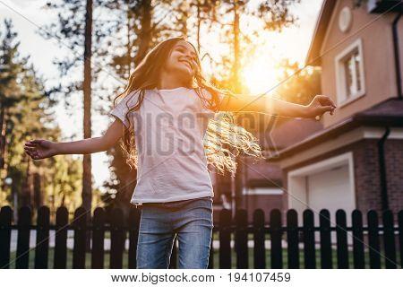 Little Girl On Backyard