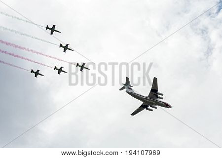 Belarus Minsk - 03.07.2017: Military transport aircraft IL-76 accompanied by combat training aircraft L-39 at the parade in Independence Day
