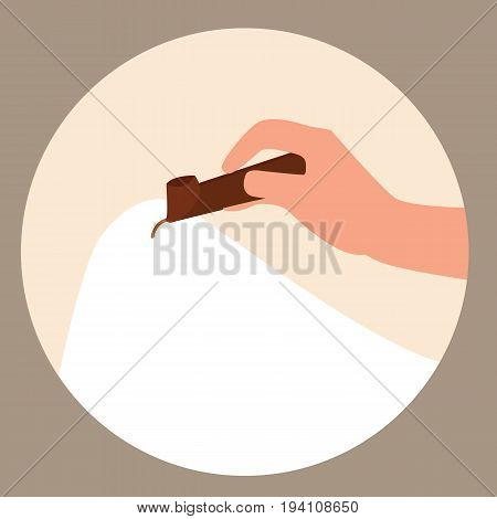 hand holding canting tools for creating batik in blank fabric vector