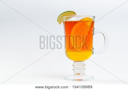 Tea with honey lemon in a glass on a white background