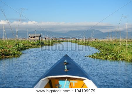 Travel boat in the local village and floating garden of Inle lake located in the Nyaungshwe Township of Taunggyi Shan State Myanmar