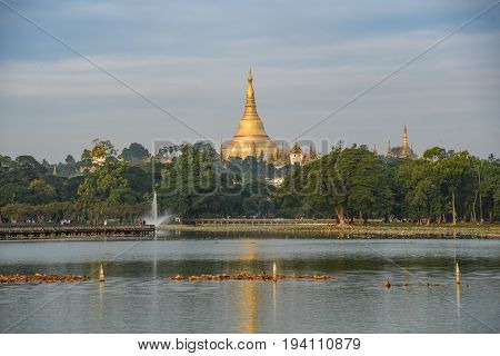 Beautiful view of golden Shwedagon pagoda (Shwedagon Zedi Daw) from kandawgyi lake famous landmark in Yangon city and is the most sacred Buddhist pagoda in Myanmar