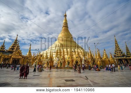 YANGON MYANMAR - DECEMBER 17 2016 : Burmese people and tourist inside the area of Shwedagon pagoda (Shwedagon Zedi Daw) famous landmark and travel destination of Yangon Myanmar.