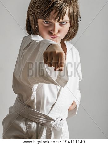 a little girl practicing karate close up