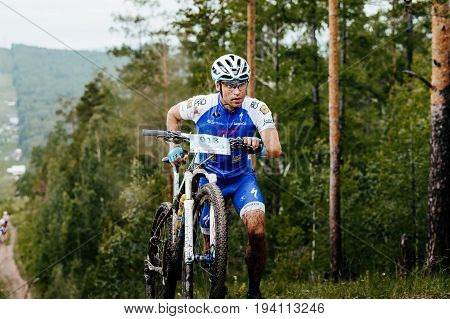 Revda Russia - July 1 2017: man athlete cyclist walk long uphill climbs during Regional competitions on mountain bike