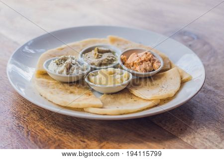 Pieces Of Pita Bread And Four Kinds Of Greek Sauces. Greek Food Concept