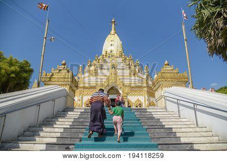 YANGON MYANMAR - DECEMBER 15 2016 : Unidentified people walk to Buddha Tooth Relic Pagoda or Swe Taw Myat Pagoda beautiful Burmese temple and one of famous attraction in Yangon (Rangoon) Myanmar.