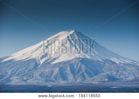 Fuji mountain (Fujisan) beautiful snowcapped volcano and famous natural landmark of Japan view from Kawaguchiko lake in Yamanashi Prefecture Japan